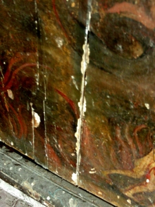 A close up on the damage on Jose Luciano Dans' 1850 mural