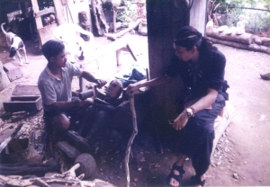 Bernanbe carving a Bulul 2001
