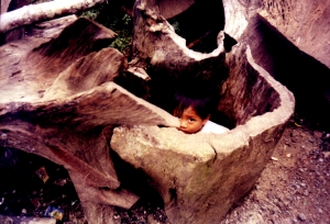 A child at play among the wooden pieces in his father's workshop 2001