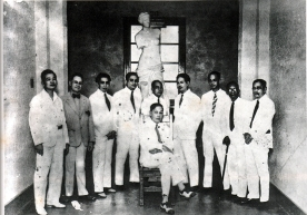 1935 U.P. School of Fine Arts faculty members, with its director, Don Fabian de la Rosa In the picture are Ambrosio Morales, Ramon Peralta, Guillermo Tolentino, Fernando Amorsolo, Dr. Toribio Herrera, Irineo Miranda, Pablo Amorsolo, Teodoro Buenaventura, and Vicente Rivera In the background is a plaster cast copy of the Venus de Milo (130-100 BCE)