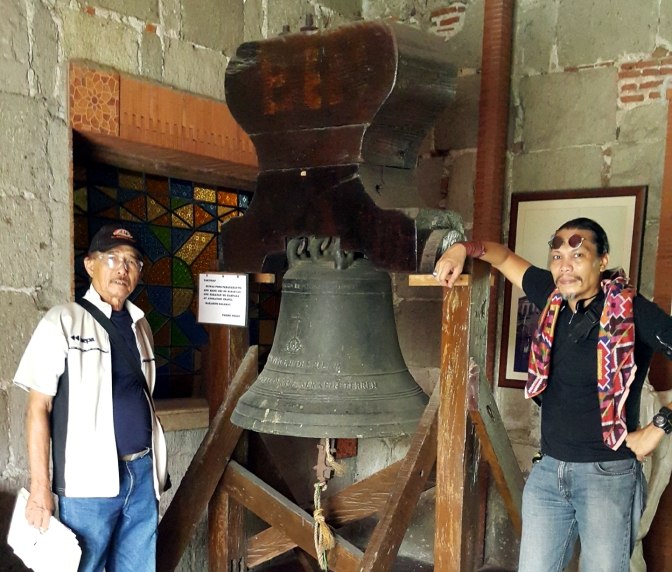 Posing with Romeo Monte, with the 1878 Bell of the Santo Niño de Pandacan Parish