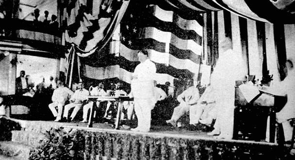 1907 William Howard Taft, with Governor-General James E. Smith, Reading President Theodore Roosevelt's proclamation establishing the Philippine Assembly