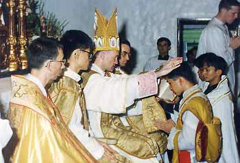 1990s Mons. Salvador Lazo, assisted by Fathers Daniel Couture and Marc Vernoy
