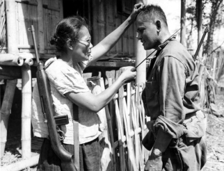 1944 Captain Nieves Fernandez demonstrating how she beheaded Japanese soldiers, Leyte
