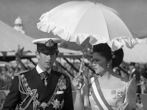 Imelda Marcos with Britain's Prince Charles at the 1975 coronation ceremony for Nepal's King Birendra
