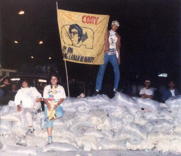 39 1986 The Author Standing over a sandbag barricade on EDSA