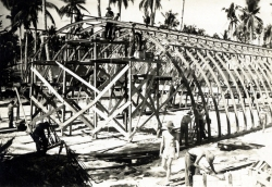 1945 American GIs building a Quonset Huts, Philippines