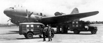 1945 WC-54 3-4-Ton 4x4 and WC-64 3-4-Ton 4x4 KD Ambulances, C-46 transport plane, Manila