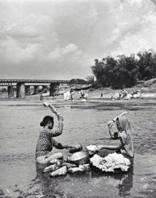 1934 Women washing clothes along the Mariquina River