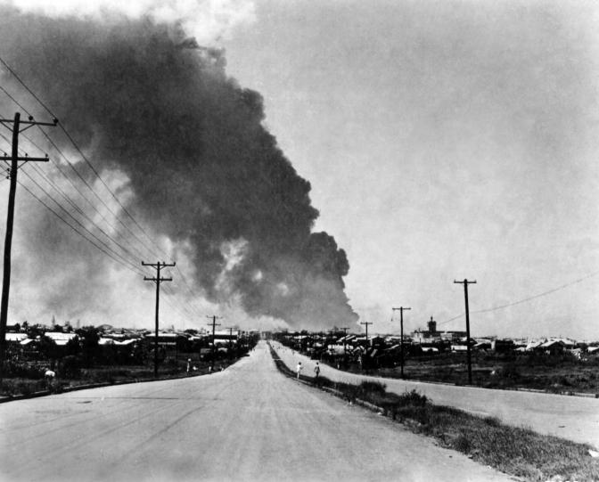 10 1945 The Uiversity of Santo Tomas burining from Santa Mesa