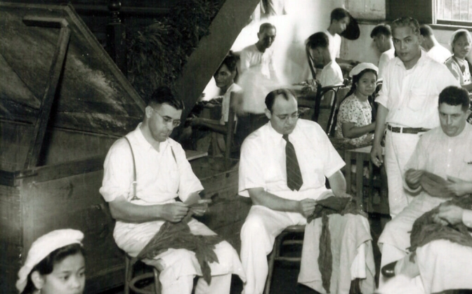 1940 The Frieder Brothers sifting through the tobacco leaves, in their Manila plant