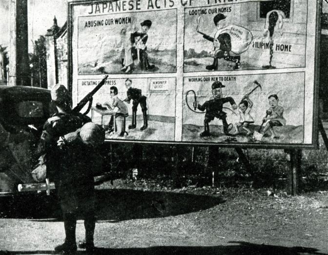 1943 A Japanese soldier looking at an American Propaganda Billboard, Manila