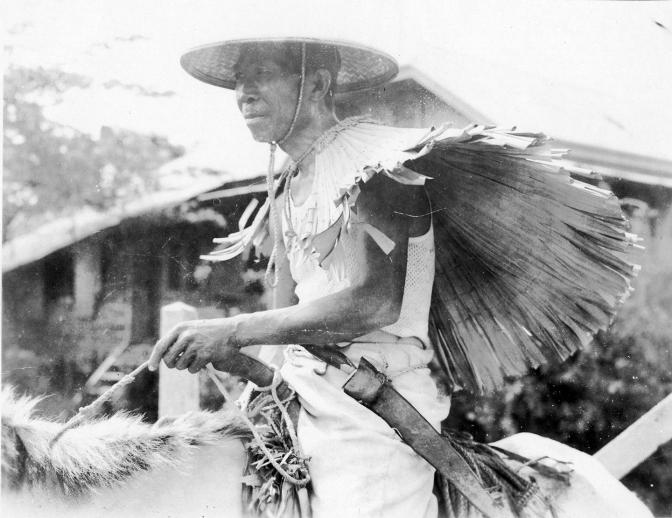 1945 A Filipino Guerilla on a horse, outside Manila
