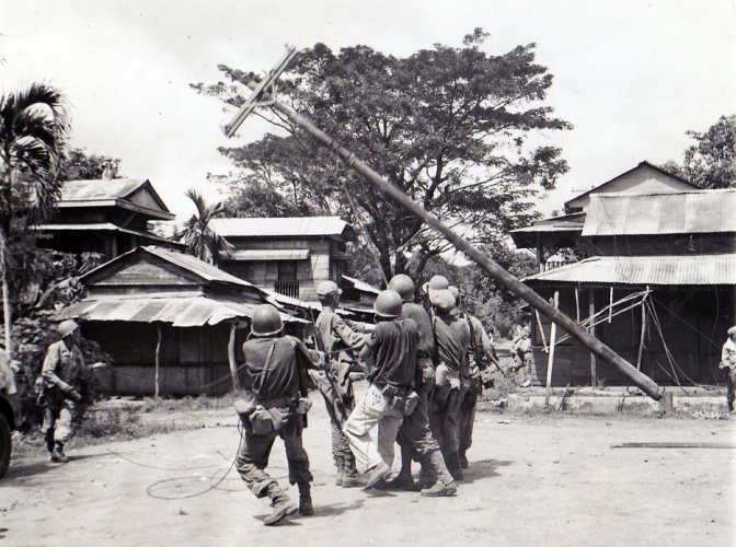 1945 American GIs repairing communication lines, Novaliches