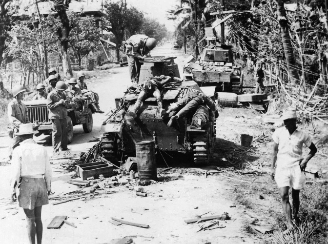 1945 January, US Military and Filipino guerillas inspect two destroyed Japanese Type 95 Ha-Go light tanks