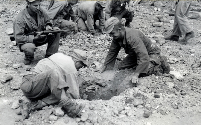 1945 The 1st Cavalry Division Demolition Squad extracting Japanese Landmines