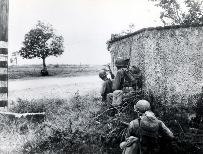 1945 US 37th Infantry Division avoid sniper fire, on the way to Novaliches, 4th of February